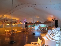 Dancelfoor and chairs inside stretch marquee